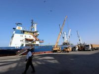 coast-guard-walks-past-a-ship-docked-at-the-red-sea-port-of-hodeidah-1
