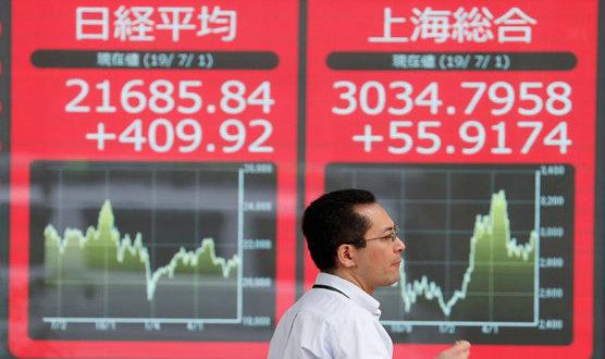 Global stocks jump as investors pin hopes on coronavirus treatment